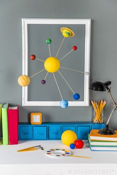 Want a study space that's out of this world? Hang a solar system mobile for bright decor that's educational too!