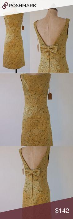 "vintage 1950s gold dress | vintage baroque dress vintage 50s gold barge style dress. Bateau neckline, sleeveless, empire waist, v-shape back neckline, detachable snap bow, back zipper closure, fully lined.  -MEASUREMENTS- Fits Like: small Tag Size: n/a Length: 37"" | 93.98cm Shoulders: 14"" | 35.56cm Bust | Chest: 34"" | 86.36cm Waist: 28"" | 71.12cm Hips: 35"" | 88.9cm  Brand | Maker: n/a Condition: excellent Vintage Dresses Midi"