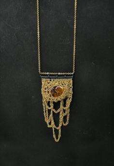 Check out this AMAZING artist:  bohemian mama golden stalactites baltic amber & by PetiteMortShop, $490.00