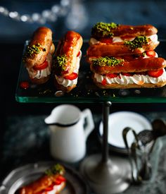Chocolate is hard to go past, but it's by no means the last word in éclair toppings and fillings. We've opted for a strawberry-flecked crème fraîche filling, contrasting with a crunchy caramel top scattered with pistachios - light, fresh and more than a little moreish.