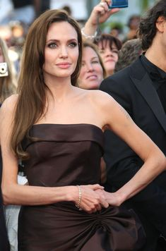 in brown silk dress