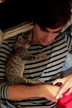 I love cats...especially if they are held by cute guys! XD