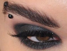 Black smoky eye makeup looks perfect for night parties