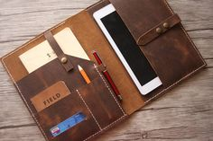 Leather 10.5 iPad Pro Case with 2 front pockets suitable for phones, notebooks, passports .etc ALL OUR LEATHER GOODS ARE 100% HANDMADE, HAND CUT, HAND SEWN, HAND STITCHED! @ If you need personalized your leather portflio with initials or logos, please visit the listng below to buy