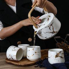 1 Pot 4 Cups Golden Teapot Set Elegant Matte Handmade Ceramic Art Ins Tea Set Marble Kettles with Wooden Trays Ceramic Teapots, Ceramic Art, Photo Deco, Tea Pot Set, Pot Sets, Teapots And Cups, Tea Service, Coffee Set, White Ceramics