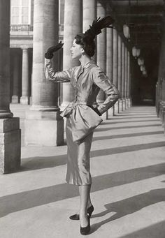 Miss M waits in the long shadows by the pillars for her contact. {1950, Paris. Model in Cristobal Balenciaga. Photo by Willy Maywald (B1907-D1995)}