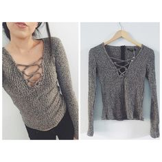 Charcoal lace up long sleeve Brand new with tags! Charcoal colored long sleeve with lace up v neck detailing. Zips up back. Thick sweater like material. Modeling a size small. Available in medium and large Tops Tees - Long Sleeve