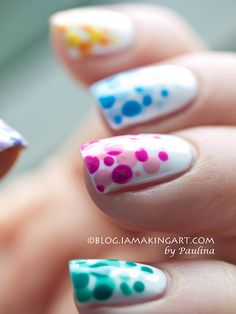 These Gradient Dots Nail Art Design look bubbly and bright for spring! You can try it this next #ManiMonday by using a white base coat, a dotting tool, and two shades of a similar color to get this effect.