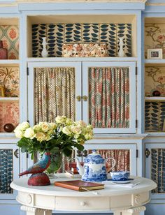 What a delightful mix of color and patterned fabrics in this built-in.  Takes a deft hand. Eliza Gatfield