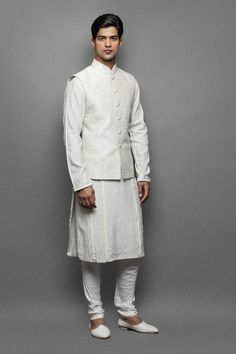 Cream frill & pintuk kurta with quilted waistcoat  This cream frill & pintuck kurta comes with a quilted waistcoat and a churidar. The quilted waistcoat comes with self zari jaal.