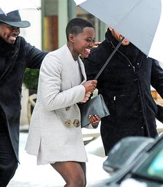 Nothing can rain on her parade! Lupita Nyong'o braves the NYC icy weather in SoHo on Feb. 13