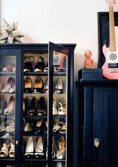 "Use an Entertainment Cabinet to Make a Shoe Armoire ""Simply use L Brackets and have some wood shelves cut to fit from a local hardware store and you have yourself a good shoe storage. You may be able to pop the front panels off and then have some glass cut to fit to finish it off!"