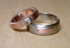 Complimentary bands, inverse colors. 14k pink and gray gold, palladium and champagne diamonds.