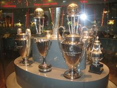 Several of AJAX's international trophies---Ajax is historically one of the MOST successful clubs in the world;  according to the IFFHS, Ajax were the 7th-most successful European club of the 20th century!!The club is one of the 5 teams that has earned the right to KEEP the European Cup that they won consecutively in 1971–1973 and to wear a multiple-winner BADGE.