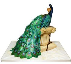 Peacock cake crafted by award-winning sculptor/sugar artist Michelle Wibowo of Michelle Sugar Art, Ltd. in West Sussex, England...breathtaking!!!