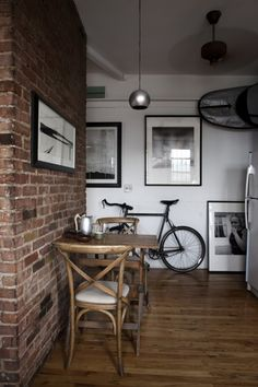 Love the table and exposed brick for apartment
