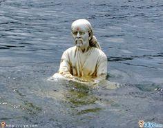Shirdi Sai Baba statue in the Kaveri river stream.   @ http://ijiya.com/