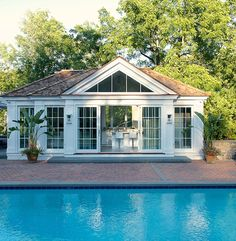 Laura Tutun Interiors - pools - pool house, sliding glass doors, pool house kitchen,  Pool house features sliding glass doors.