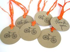 Wedding favor tags, 10 bicycle gift tags, brown kraft hand stamped, hand dyed orange raffia hang tag, birthday Thank you labels. $5.95, via Etsy.