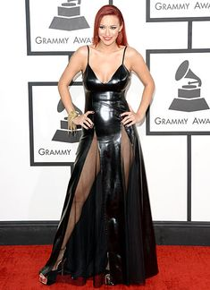 Kaya Jones The singer wore a black leather dress with hip-high slits with sheer fabric to the Grammys on Jan. 26 in Los Angeles.