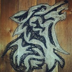 Wolf string art on reclaimed fence boards
