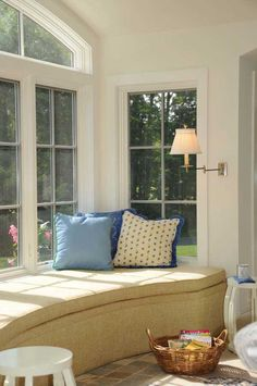 http://freshome.com/2011/11/29/36-cozy-window-seats-and-bay-windows-with-a-view/