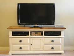 How to turn an old dresser into an entertainment center. Some sanding, staining, tung oil, primer and spray paint. One stop shop with Rust-Oleum products!