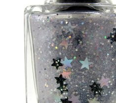 Clear polish base with holographic silver stars, black stars, silver holo hex and a holographic silver flash. Gorgeous over black polish! Full Size - 15ml  All Pinup Beauty polishes are Five Free  No Camphor, Toluene, Formaldehyde, Formaldehyde Resin, or Camphor  Swatches coming soon