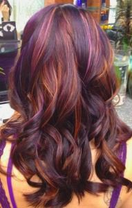 Long hair with purple, red, and gold highlights.