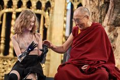 HH Dalai Lama looking at Tilly Lockey's prosthetic hands during the discussion on 'Robotics and Telepresence' at De Nieuwe Kerk in Amsterdam, Netherlands on September (Photo by Olivier Adam) - Funny Photoshop Pictures, 14th Dalai Lama, Dharamsala, News Highlights, Medicine, Sari, The Incredibles, Couple Photos