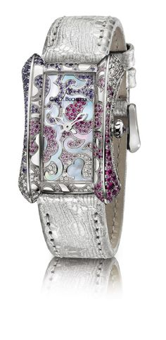 Swiss watch brand Carl F. Bucherer is a  master at women's elegant watches in its Alacria collection.  This newest piece – created in white gold – features blooms of intertwined roses set with precious gems. The exquisite case is set with 137 shimmering sapphires and 137 diamonds. Even the mother-of-pearl dial is meticulously set with 89 sapphires and 26 diamonds. It is accented with a high-quality decorative strap made of goatskin.  Just 125 pieces will be made.