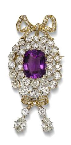 An amethyst and diamond brooch/pendant The cushion-shaped amethyst within a tiered double surround of old brilliant-cut diamonds suspending a diamond-set bow with two brilliant and two pear-shaped diamonds, and a similar surmount, diamonds approximately 12.00 carats total, length 6.9cm
