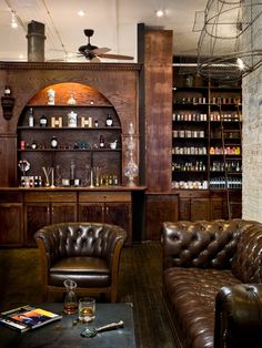 Wooden bar scene with leather chairs and couch.