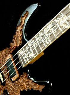 """Pin 2 of 2, perspective from top: Blueberry """"Fierro"""" Electric Bass Guitar. RESEARCH #DdO:) - https://www.pinterest.com/DianaDeeOsborne/instruments-for-joy/ - INSTRUMENTS FOR JOY. This $1,000 magnificent electric bass with mahogany body & engraved wood inlays on a rosewood fretboard has a FIERRO motif. Features custom Langcaster pickups from New Zealand. Full front angle on pin https://www.pinterest.com/pin/349732727288712417/ - MORE BASSES at…"""