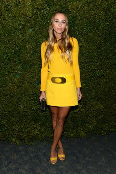 Harley Viera Newton in sun ribbed long sleeve crewneck, circle pocket skirt, belt and sandals all from the Michael Kors Spring 2013 collection.