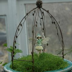 """Fairy Vine Arbor measures 9.5"""" high x 6"""" wide x 4"""" deep, not including the picks.  Shown here with The Cat's Ear Fairy (not included). Price: $12.99"""