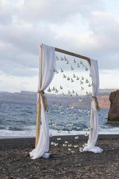 Santorini bohemian beach wedding| wedding arch -white carnations