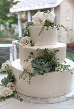 Tri-tier round white wedding cake with succulents and white roses.JPG