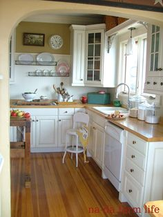 I like this small kitchen design! English kitchen can be (and are) notoriously small compared to American ones, so this is a great use of space! :)