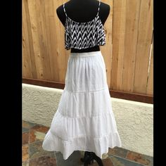 """White Gauze Maxi Skirt This white maxi skirt is 38.75"""" long. The elastic waist is 14.5"""" wide and 20.75"""" pulled. The shell and exterior are both 100% Cotton. The skirt is in great condition. NO spots or damage. Old Navy Skirts Maxi"""