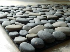 I can do this!!! For Outdoors, not bathroom.  Too small a bathroom. Ocean Stone Bath Mat (5)