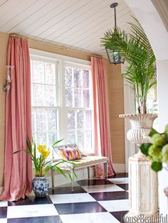 Pink linen curtains might be unpredictable with a marble-and-granite checkerboard floor and grass-cloth walls, but designer Ruthie Sommers knew they would add pizzazz to her entry hall in her Los Angeles home.