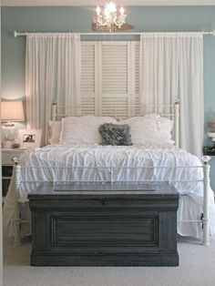 bed in front of window -shutters for inside?  (I know where to get some, this would look awesome @Melissa Squires Wade )
