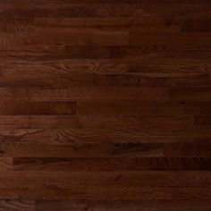 Prefinished solid traditional brown oak in warm walnut. As a #2 common grade, this product shows natural variations, manufacturing imperfections, pronounced character, and contrasting appearance.