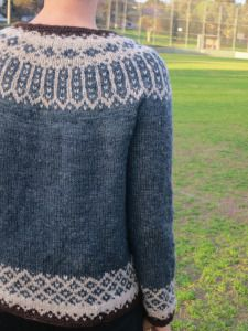 Talisman: designed and made by needleandspindle. Uses a stitch pattern from Finland. Bottom up, in-the-round, yoke sweater with short rows to raise the back neck.