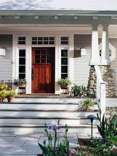 love the porch and cobblestone columns