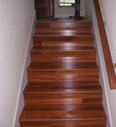 Consider laminate for your staircase; it looks great & is much cheaper than hardwood.