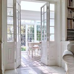 The 2 things I miss about my old house. these doors with wraparound bookshelves and the kitchen. This view was my favourite! Interior Double French Doors, Open Plan Kitchen Living Room, Dining Room, Farmhouse Remodel, Ivy House, White Rooms, Big Houses, Windows And Doors, Cottage Style