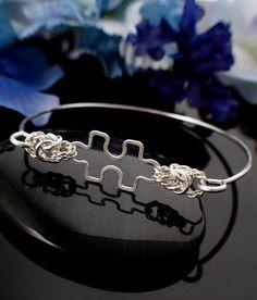 Autism Awareness Bangle - Twisted Elegance Sterling Silver Puzzle Piece Bracelet