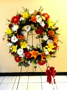 Round tribute wreath with mixed flowers